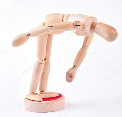 Human wooden dummy bending down.